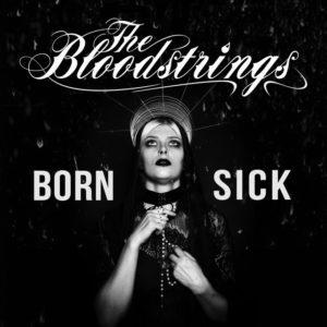 Cover der LP Born Sick Sängerin gekleidet wie eine Maria in Schwarz